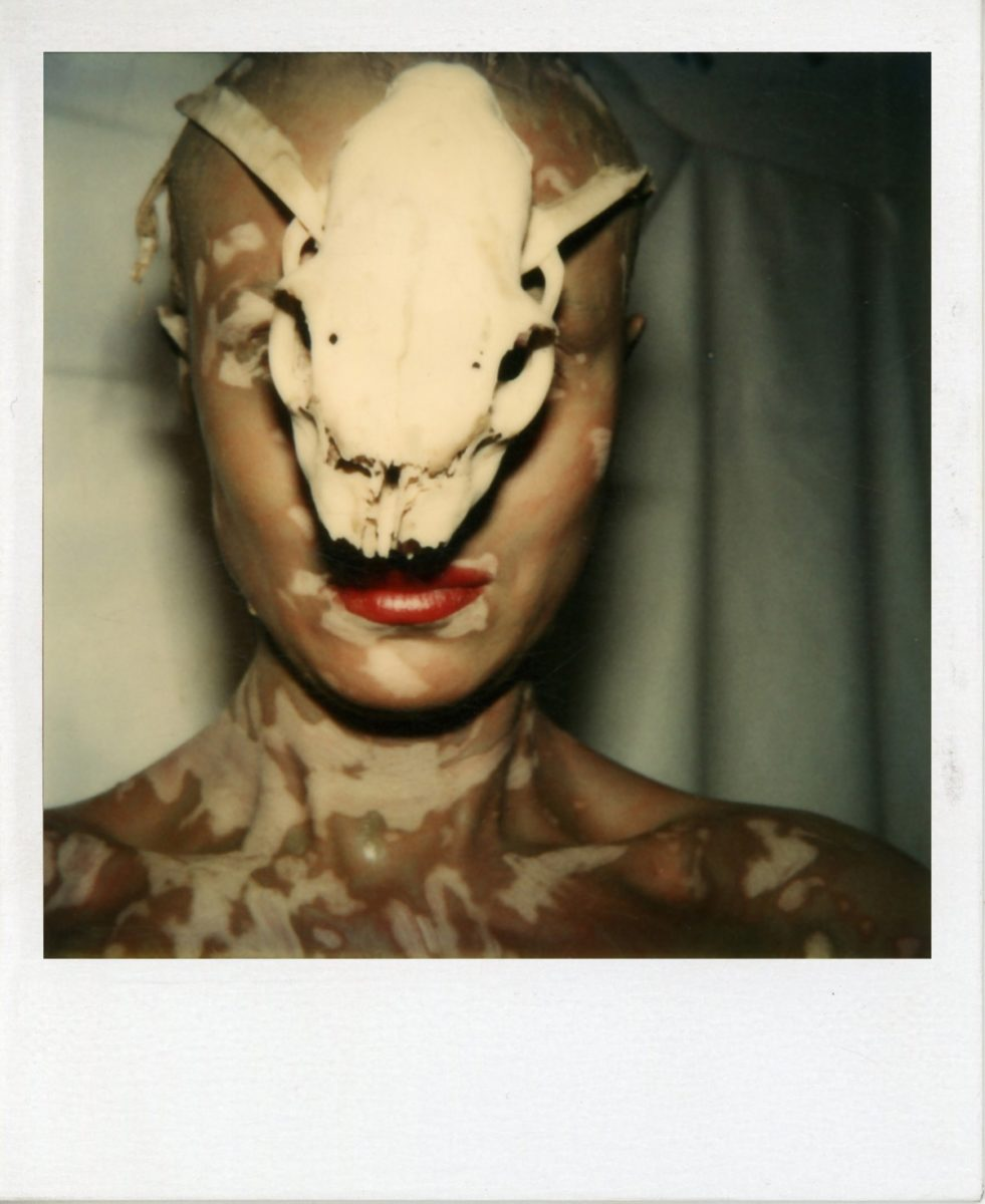 Birgit Jürgenssen Ohne Titel (Selbst mit Schädel) / Untitled (Self with Skull), 1979 SX 70 Polaroid unframed: 10,5 x 8,7 cm; framed: 34 x 29 cm Estate Birgit Jürgenssen (ph153) Estate Birgit Jürgenssen, courtesy of Galerie Hubert Winter, Vienna