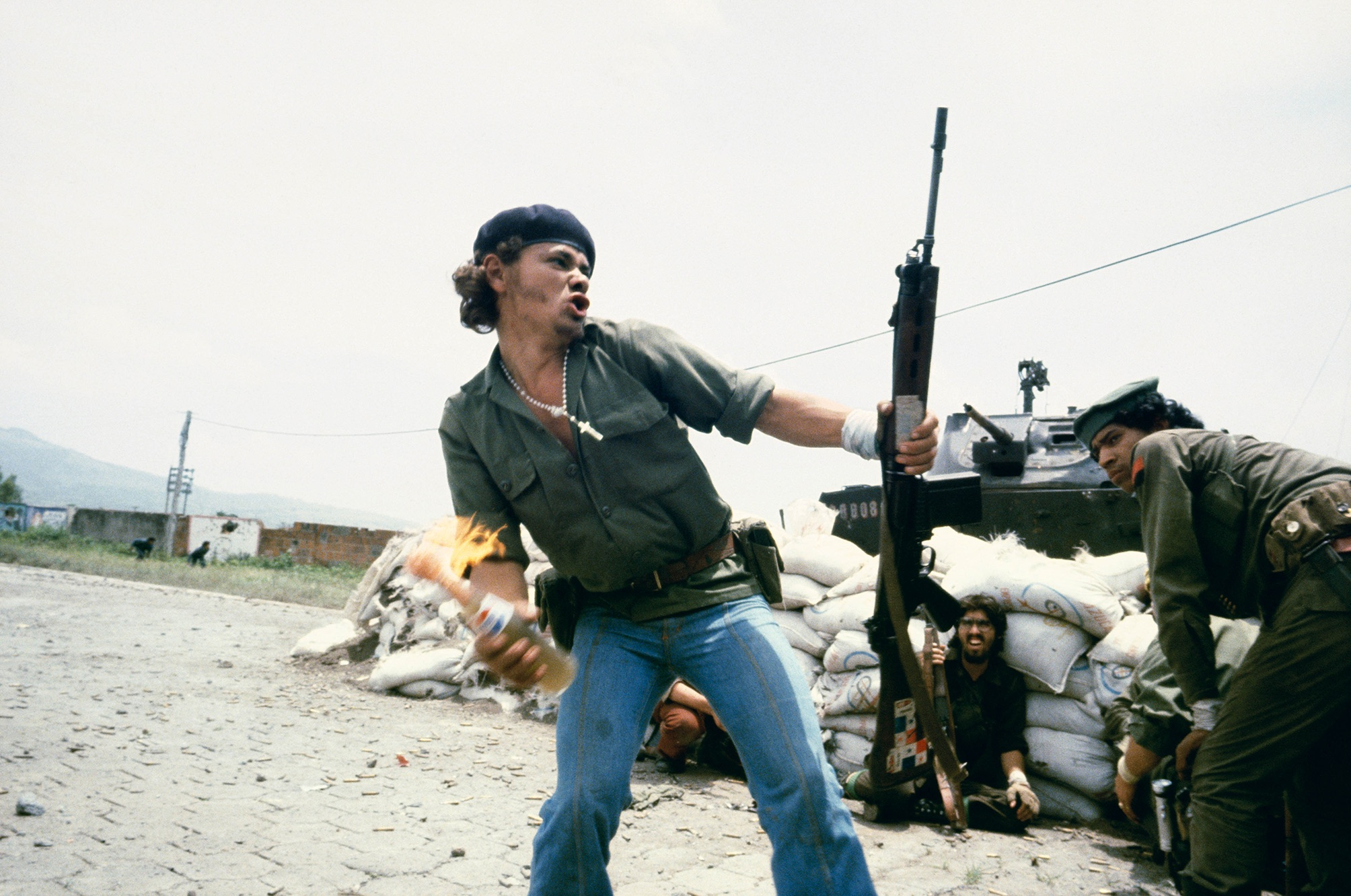 "Susan Meiselas, Sandinistas at the gates to the district of National Guard in Esteli, ""Man with Molotov Cocktail"", Nicaragua, 16 July 1979 © Susan Meiselas_ Magnum Photos"