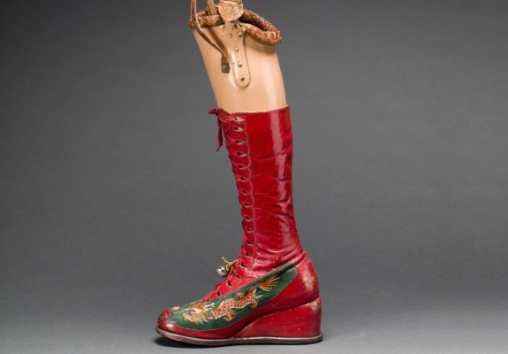 Prosthetic leg with leather boot. Appliquéd silk with embroidered Chinese motifs. From Frida Kahlo: Making Her Self Up, 16 June-14 November. Sponsored by Grosvenor Brit-ain & Ireland. Photograph Javier Hinojosa. Museo Frida Kahlo. © Diego Riviera and Fri-da Kahlo Archives.jpg