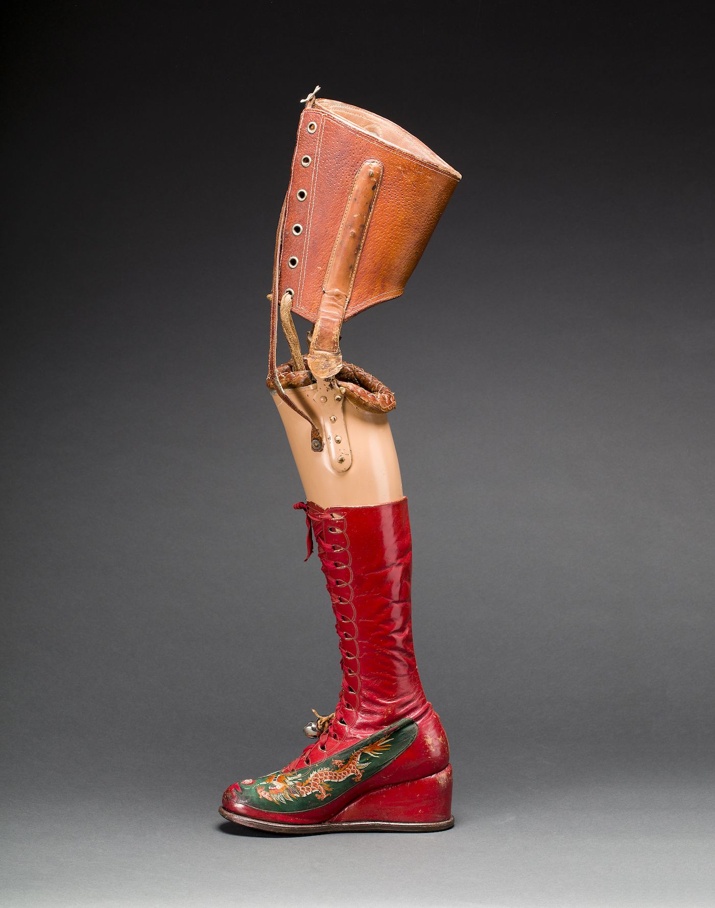 Prosthetic leg with leather boot. Appliquéd silk with embroidered Chinese motifs. From Frida Kahlo: Making Her Self Up, 16 June-14 November. Photograph Javier Hinojosa. Museo Frida Kahlo. Diego Riviera and Frida Kahlo Archives