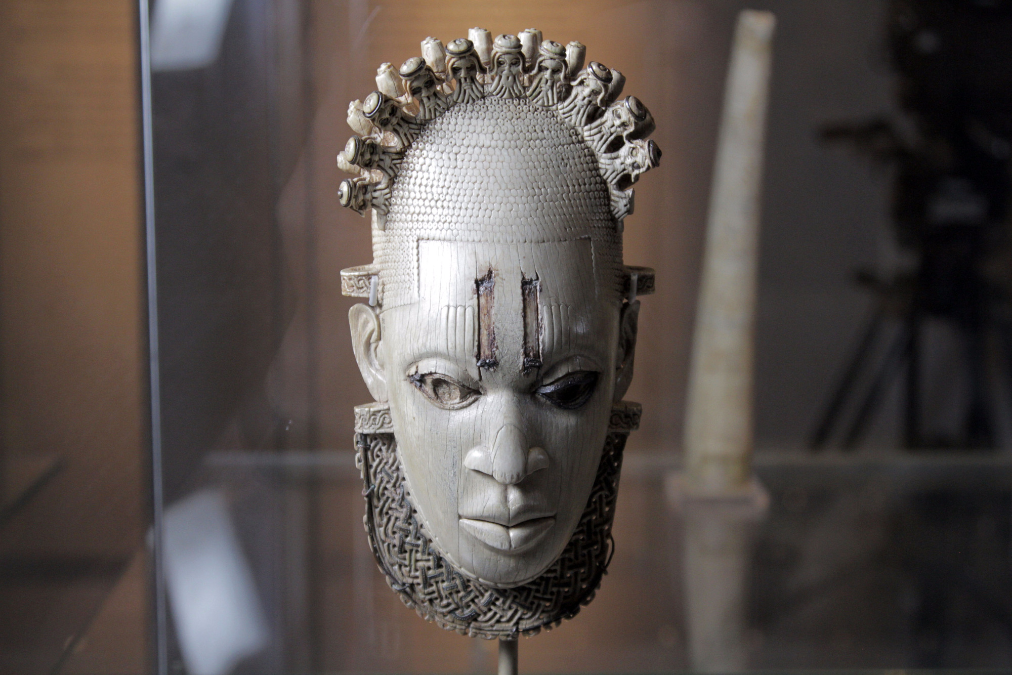 Carved Ivory mask-shaped hip pendant, inlaid with bronze Benin, Queen Idia, Artisit Unknown (16th century) British Museum, London. Photographer: Nutopia