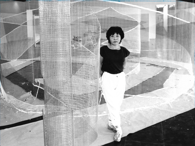 Lydia Okumura in front of her sculpture Labyrinth, Museu de Arte Moderna, São Paulo, 1984