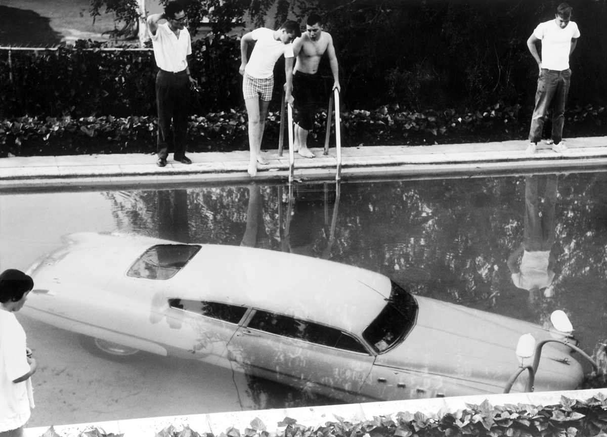 4th May 1961: A submerged car which its drunken owner 'parked' in a swimming pool in Beverly Hills, California, believing it to be a parking space. Nobody was injured in the process. Photo by Keystone/Getty Images