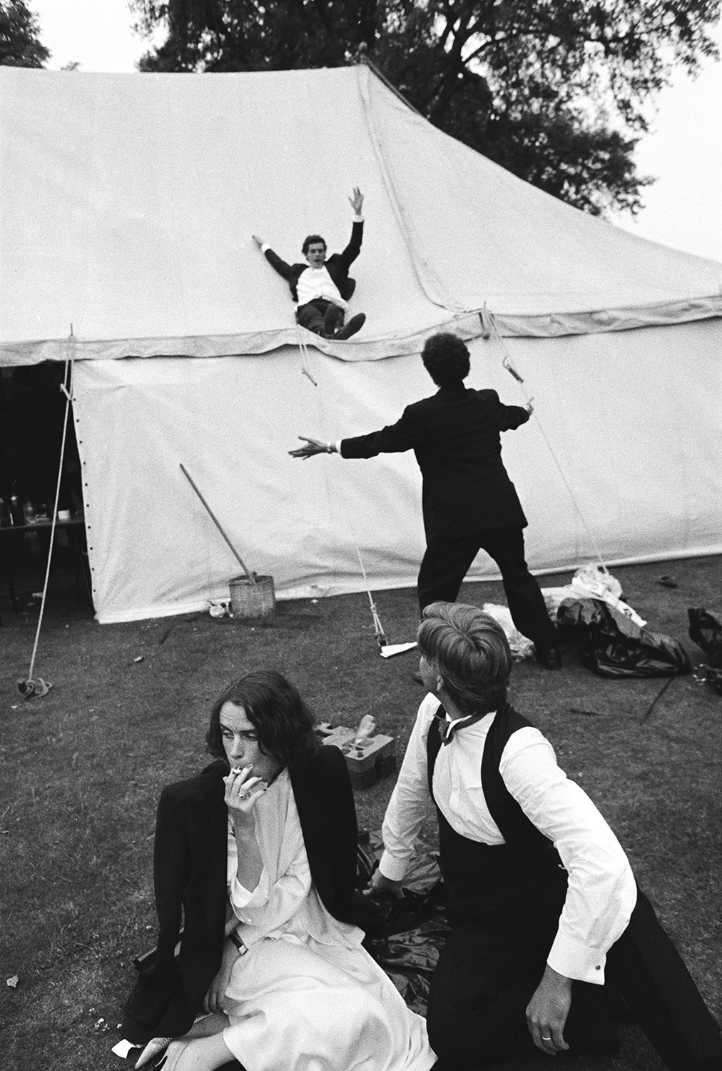 Sliding down the marquee during the New College May Ball. Oxford. 24 June 1983 © Dafydd Jones, from the book The Last Hurrah published by STANLEY/BARKER