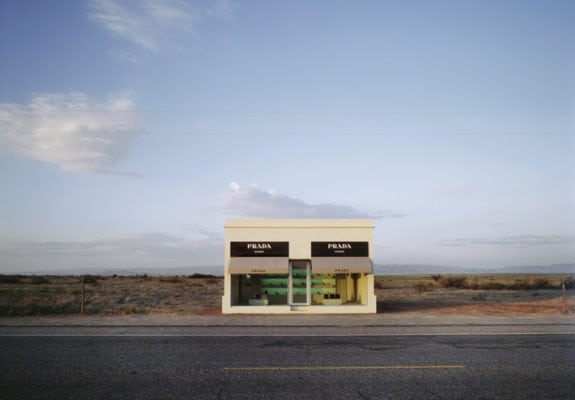 Prada Marfa, 2005. Adobe bricks, plaster, aluminium frames, glass panes, MDF, paint, carpet, Prada shoes and bags, 760 x 470 x 480 cm