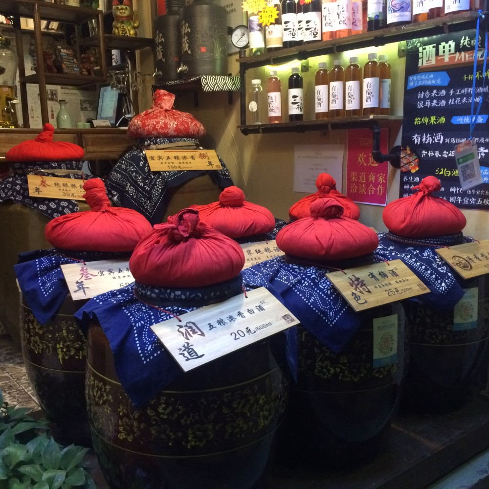 Tiny shops sell traditional Chinese alcohol, which sits in vast ceramic pots topped with weighty bags of rice. You can sample the gently tinted liquid...