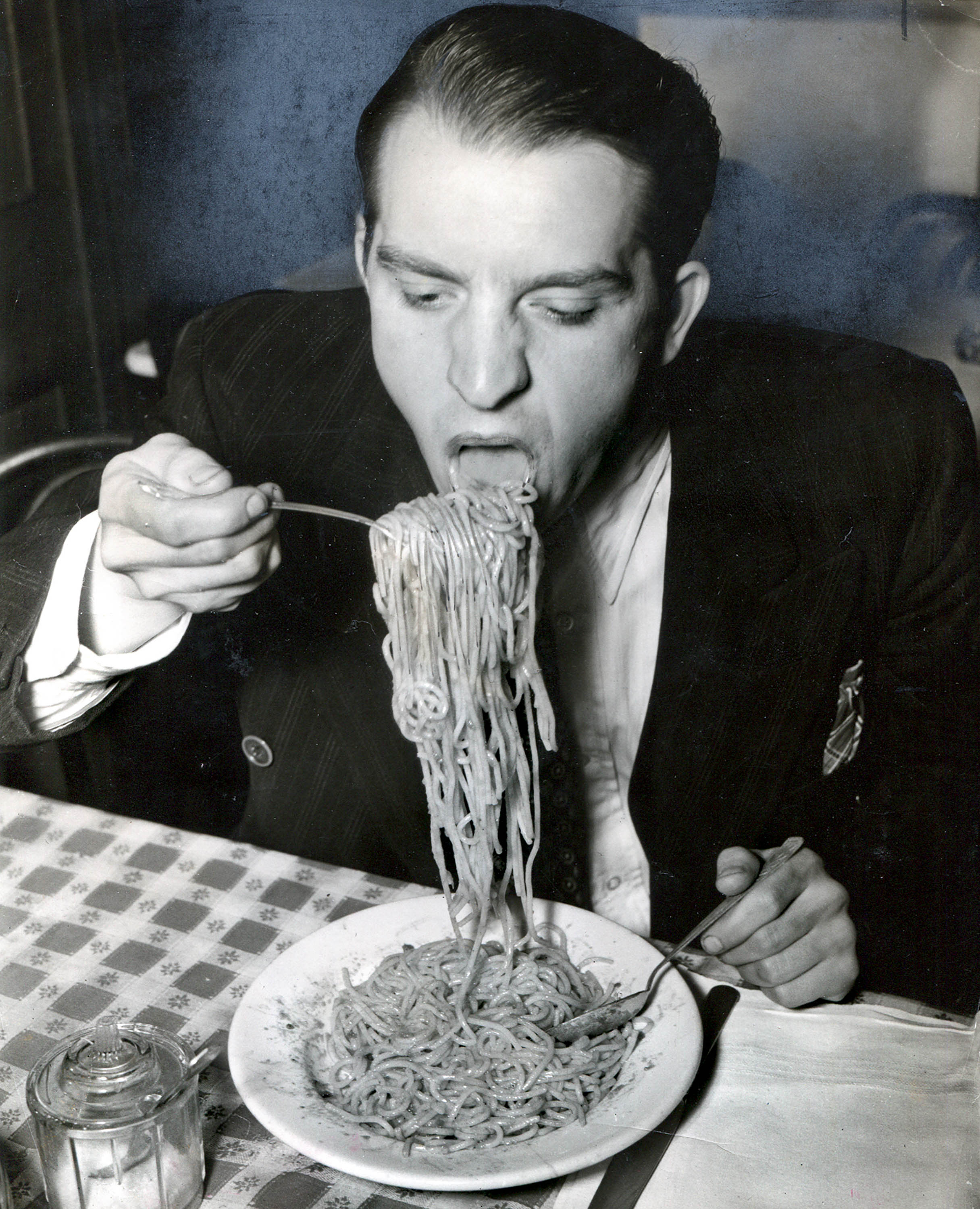 Phillip J. Stazzone is on WPA and Enjoys His Favourite Food as He's Heard That the Army Doesn't Go in Very Strong for Serving Spaghetti, 1940, Weegee / International Centre of Photography, Courtesy Ira and Suzanne Richer