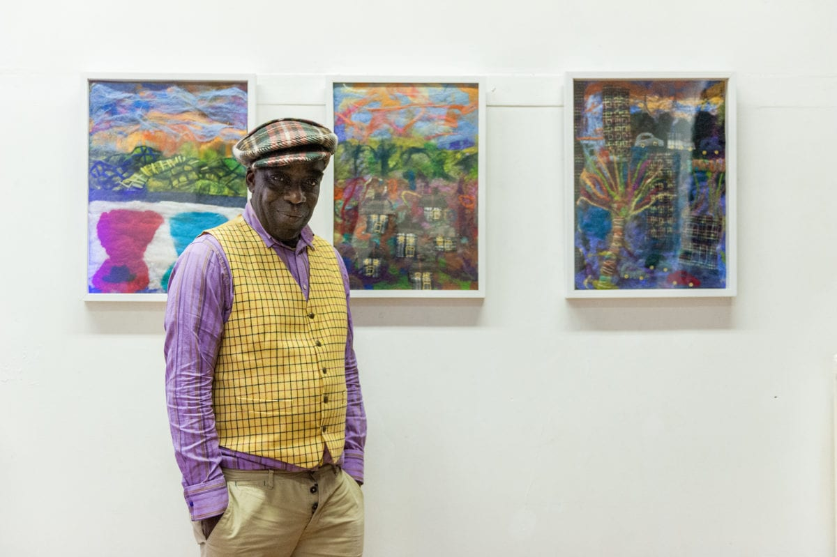 Luton born milliner, designer and artist Alva Clifford Wilson with his felt paintings as part of 'HIVE', a project developed in collaboration with creative producer Julia Cheng, 2018.