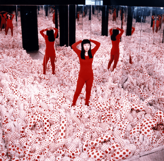 Yayoi Kusama posing in Infinity Mirror Room— Phalli's Field in the Castellane Gallery, New York © Yayoi Kusama