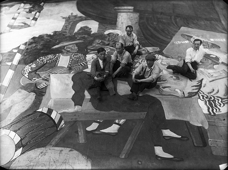 Pablo Picasso and scene painters on the set of Ballets Russes Parade, 1917, via Wikimedia Commons