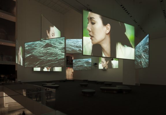 "Isaac Julien, Ten Thousand Waves, 2010. Nine-screen installation, 35mm film transferred to High Definition, 9.2 surround sound, 49' 41"". Installation view, the Museum of Modern Art, New York, 2013. Courtesy of the artist, Metro Pictures Gallery, New York and Victoria Miro, London/Venice. Photographer: Jonathan Muzikar"