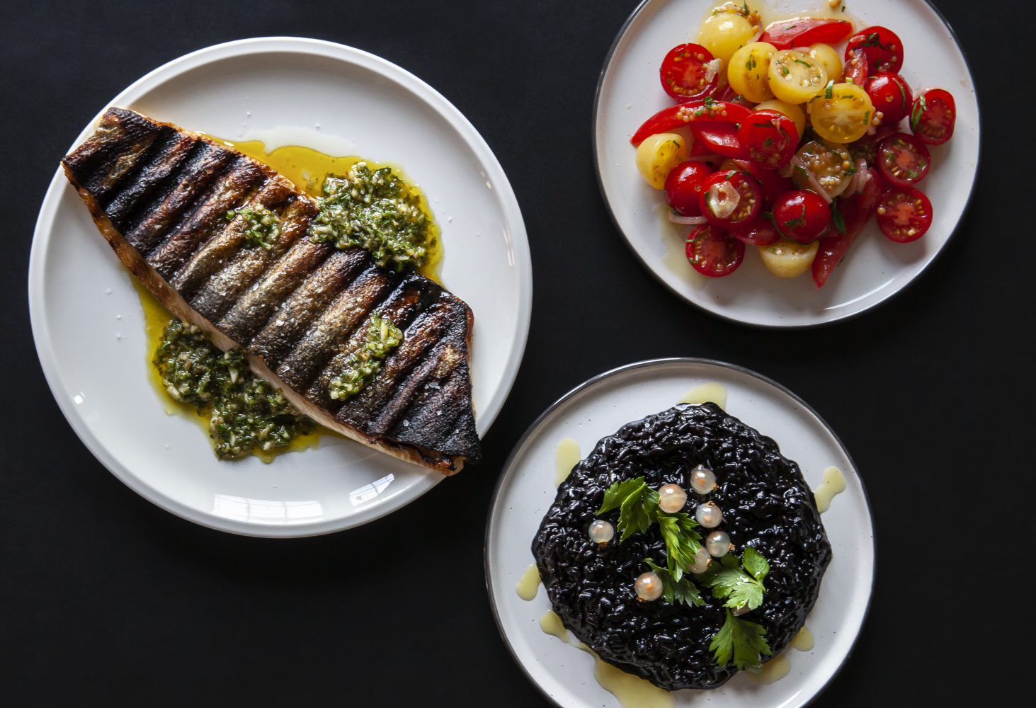 Wild caught trout, black venere rice and white currants tomato salad, from Olafur Eliasson's restaurant pop-up. Photo by Maria Del Pilar Garcia Ayensa/Studio Olafur Eliasson.