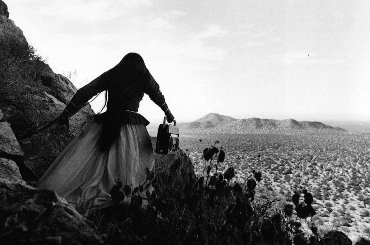 Graciela Iturbide, Mujer Ángel, Desierto de Sonora (Angel Woman, Sonoran Desert), 1979 (printed 2014); Gelatin silver print, 16 x 20 in.; National Museum of Women in the Arts, Gift of Cindy Jones; © Graciela Iturbide; Image courtesy of Throckmorton Fine Art, New York