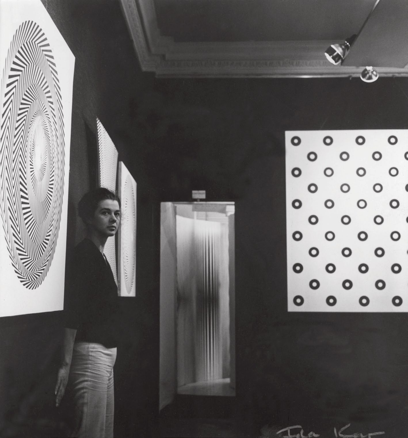 Bridget Riley in her second solo exhibition at Gallery One, London, photo by Ida Kar. Image from the book Bridget Riley A Very Very Person.