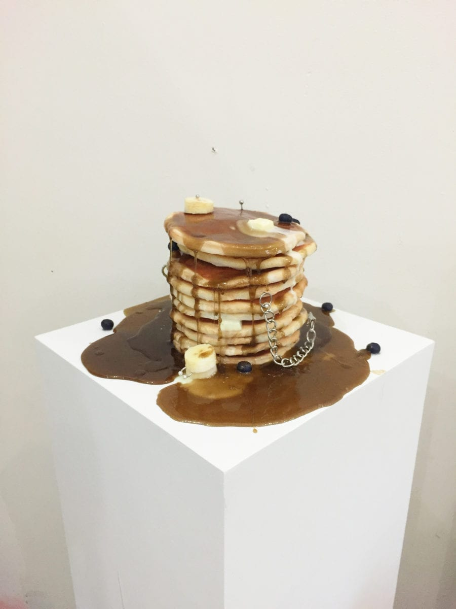 Chloe Wise, International II Oil paint, urethane, piercings, chain, wood plinth, 2015, Courtesy the artist