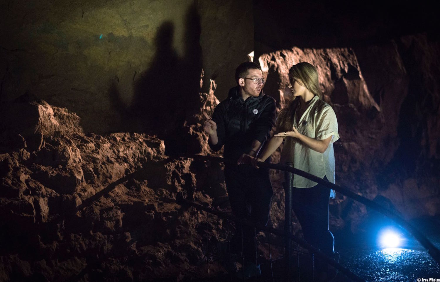 Entirely hollow aside from the dark, AlanJames Burns and Sue Rainsford discussing the work in Aillwee Caves, 2017. Photo by Trevor Whelan.