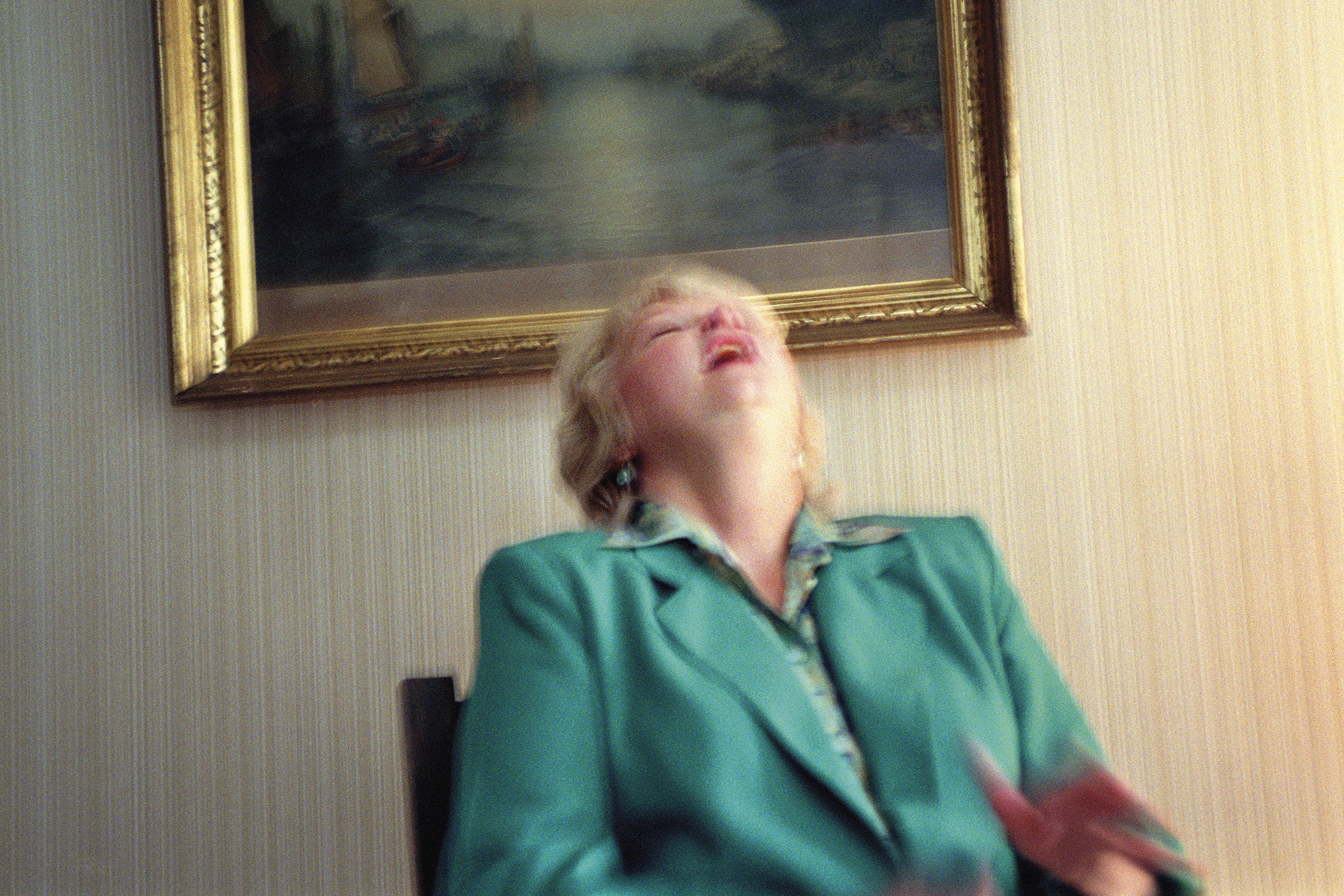 Gretchen Clark laughs as her deceased brother Chapman interrupts a reading to tell her a joke, Lily Dale, New York, 2001. From Séance by Shannon Taggart