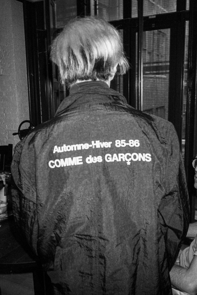 Andy Warhol modeling his new Comme des Garçons jacket at the Con Edison building, New York 1985