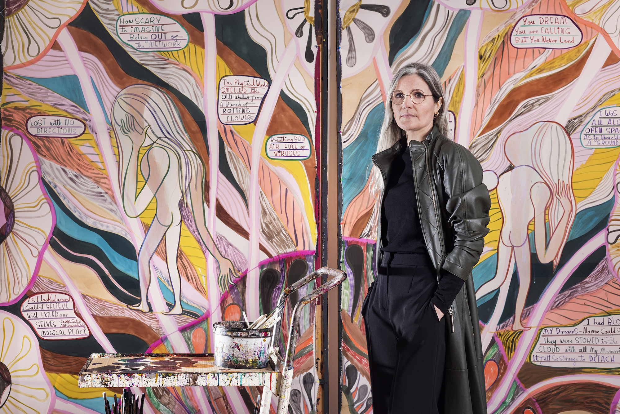 Emma Talbot, portrait in the artist's studio, pictured with When Screens Break, 2020. Photo by Thierry Bal